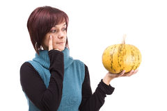 Girl and pumpkin. Young girl with a yellow pumpkin in her hands royalty free stock images
