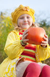 Girl with pumpkin Stock Photos