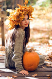 Girl with a Pumpkin royalty free stock image
