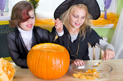 Girl while pumpkin carving Stock Image