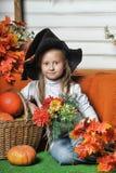 Girl with pumpkin Stock Image
