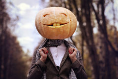 Girl with pumpkin head Royalty Free Stock Photo