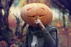 Girl with pumpkin head Stock Images