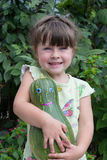 Girl and pumpkin Stock Image