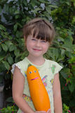 Girl and pumpkin Royalty Free Stock Photos