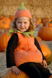 Girl in pumpkin patch Royalty Free Stock Photo