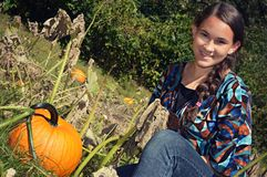 Girl in Pumpkin Patch Stock Photos