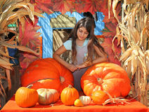 Girl pumpkin patch royalty free stock photos