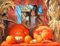 Girl pumpkin patch Royalty Free Stock Photos