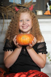Girl with pumpkin Stock Images