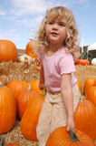 Girl pumpkins 2 Royalty Free Stock Photography