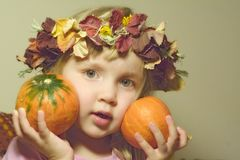 Girl with pumpkins royalty free stock photo
