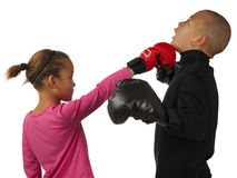 Girl punches boy Stock Images