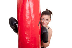 Girl with punching bag Royalty Free Stock Photos