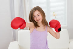 Girl Punching With Boxing Gloves Royalty Free Stock Images