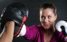 Girl Punching Mitt Royalty Free Stock Photos