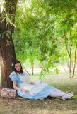 Girl pupil fell sleep under a tree with a book. Stock Images