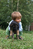 Girl with puppy. Little girl holding a german sheppard puppy Royalty Free Stock Photos