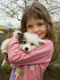 Girl and puppy. Portrait of beautiful girl with a nice little puppy Stock Photography