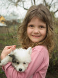 Girl and puppy. Beautiful girl with a nice little puppy Royalty Free Stock Image
