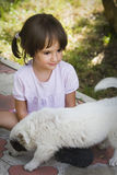 Girl and puppy Stock Photo