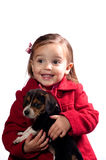 Girl with puppy. Girl holding her new puppy Royalty Free Stock Photography