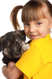 Girl with puppy. Portrait of little girl with cute puppy isolated on white background stock images