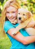 Girl with Puppy Stock Photography
