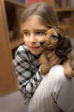 Girl and puppy dog Stock Photography