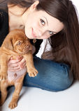 Girl with puppy of Dogue de Bordeaux Royalty Free Stock Photography