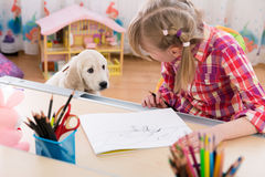 Girl and puppy friends Royalty Free Stock Photography