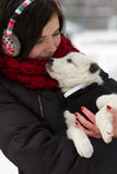 Girl with a puppy outdoors in winter Stock Photos