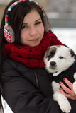 Girl with a puppy outdoors in winter Stock Photo
