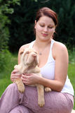 Girl with a puppy sharpei. Young girl hugs a sharpei puppy Royalty Free Stock Photos