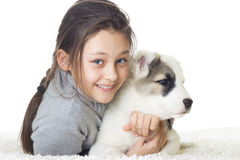 Girl and puppy Shepherd Stock Photo