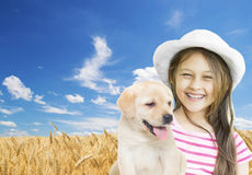 Girl and puppy Royalty Free Stock Image