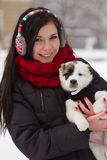 Girl with a puppy in winter Stock Images