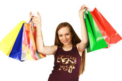 Girl with purchases. The girl with different packages - purchases Stock Image