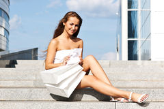 Girl with purchases Royalty Free Stock Photo