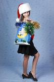 Girl with purchases on Christmas. Royalty Free Stock Images