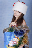 Girl with purchases on Christmas. Stock Image