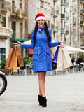 Girl with purchases during the Christmas sales Royalty Free Stock Photos