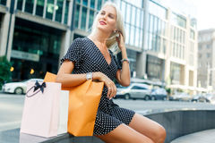 Girl with purchases in dress Stock Image
