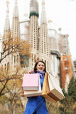 Girl with purchases at street in Barcelona Stock Images