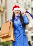 Girl with purchases at street Royalty Free Stock Photography