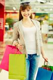 Girl with purchases Stock Images