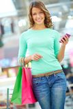 Girl with purchases Royalty Free Stock Photos