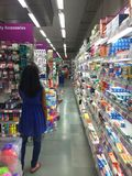 A Girl purchasing household items at departmental store Stock Image