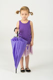 A girl in a purple clothes with umbrella Royalty Free Stock Photo