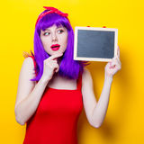 Girl with purple color hair and blackboard Royalty Free Stock Images